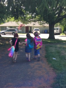 B and her girlfriends skipping home on the last day of Kindergarten.